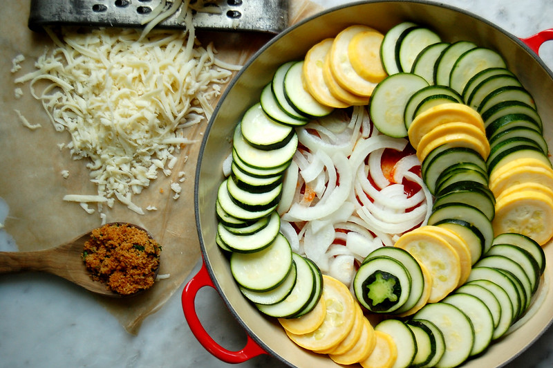 raw swirl of zucchini and yellow squash in casserole with mozzarella and onion