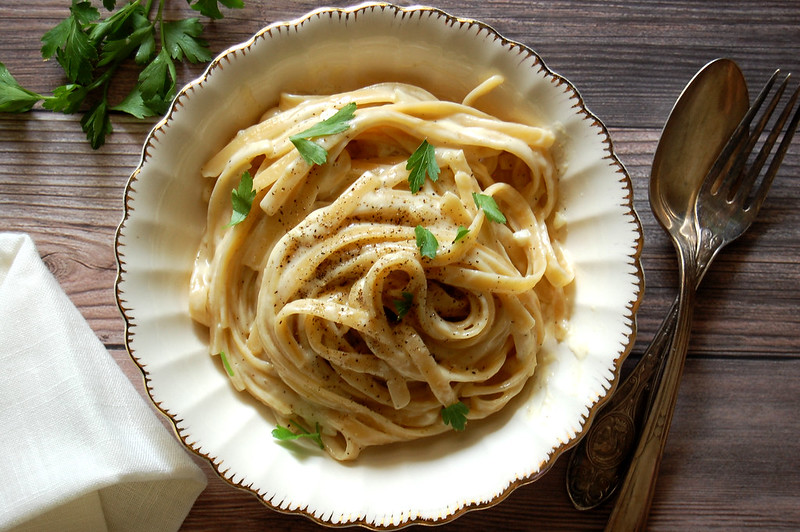 bowl of creamy fettuccini pasta on wooden table