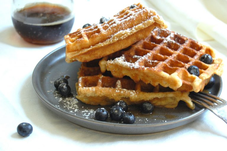 vertican stack of buttermilk waffles with wheat flour and blueberries