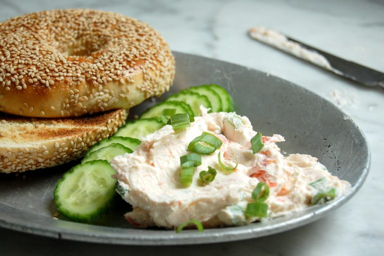 salmon cream cheese on plate with bagel and cucumber slices