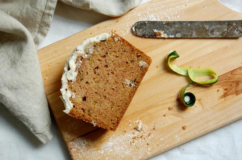 slice of zucchini dump cake on wood board