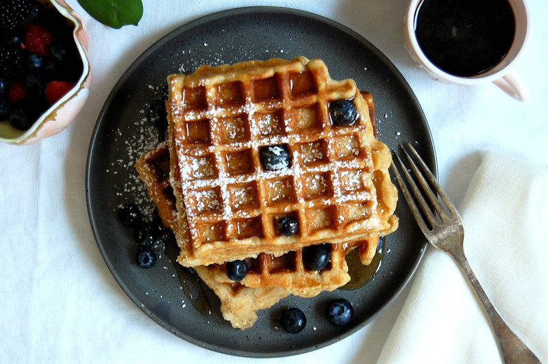 gray plate of whole wheat buttermilk waffles with blueberries