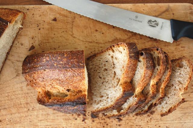 bread sliced on wooden board