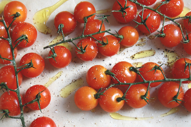 grape tomatoes on the vine with olive oil