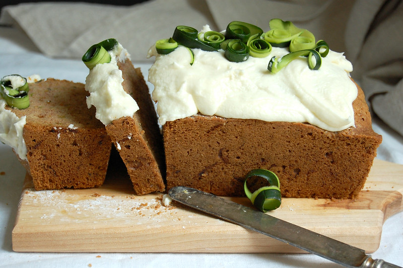 slices of zucchini dump cake on wood board perfect late summer dessert recipes