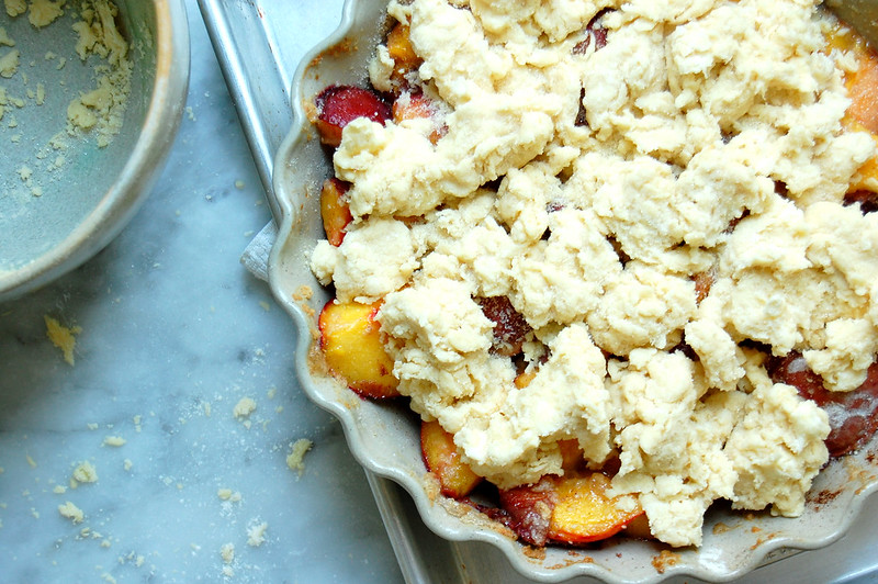 raw peach cobbler with biscuit topping