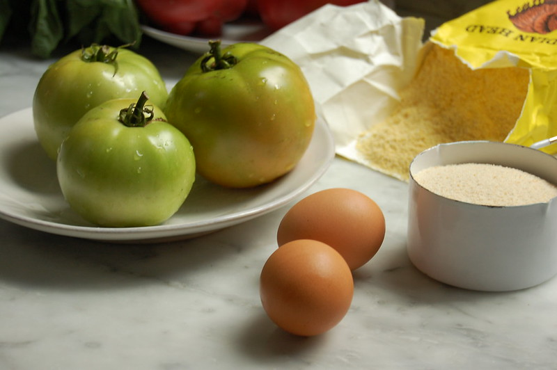 fried green tomatoes recipe ingredients egg breadcrumbs tomatoes cornmeal on marble