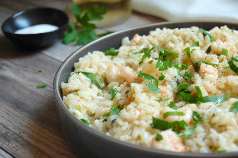bowl of shrimp scampi risotto with parsley