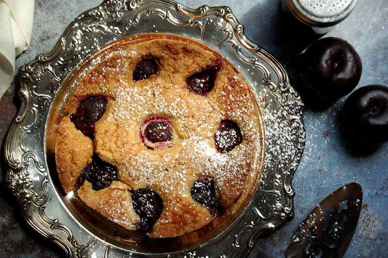 overhead picture of nytimes plum torte cake on silver tray