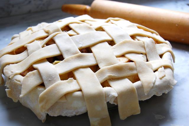 raw caramel apple lattice pie with rolling pin