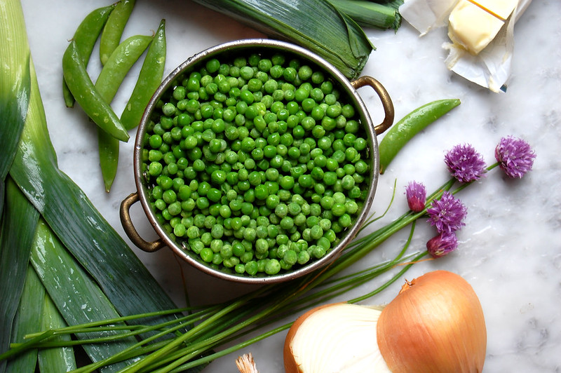 peas and onion and chives on marble