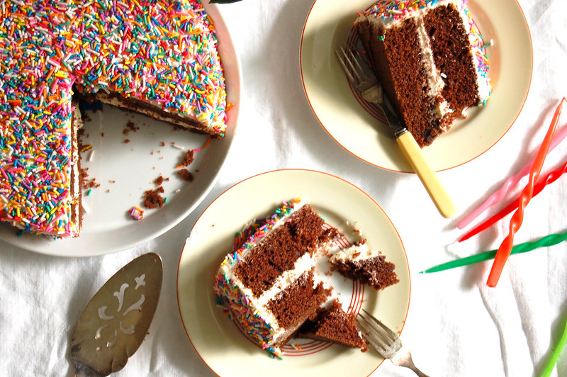 food coloring free velvet layer cake slices on plates with sprinkles birthday party spread