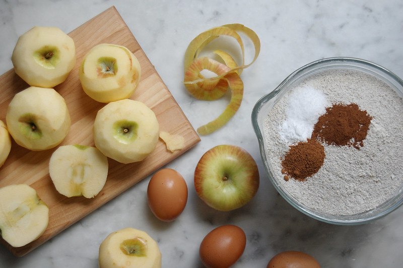 apples on cutting board with cake dry ingredients
