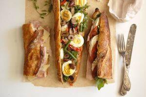 3 baguette sandwiches jambon beurre goat cheese pan bagnant on paper mat lunch ideas