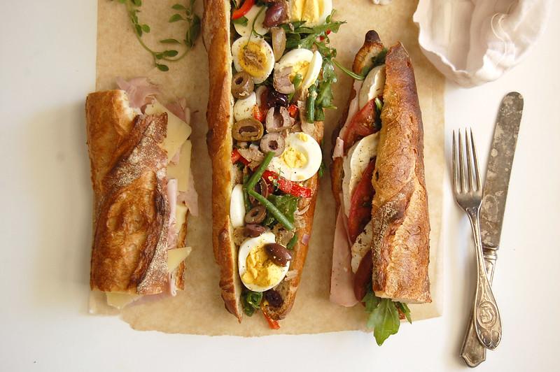 3 baguette sandwiches jambon beurre goat cheese pan bagnant on paper mat