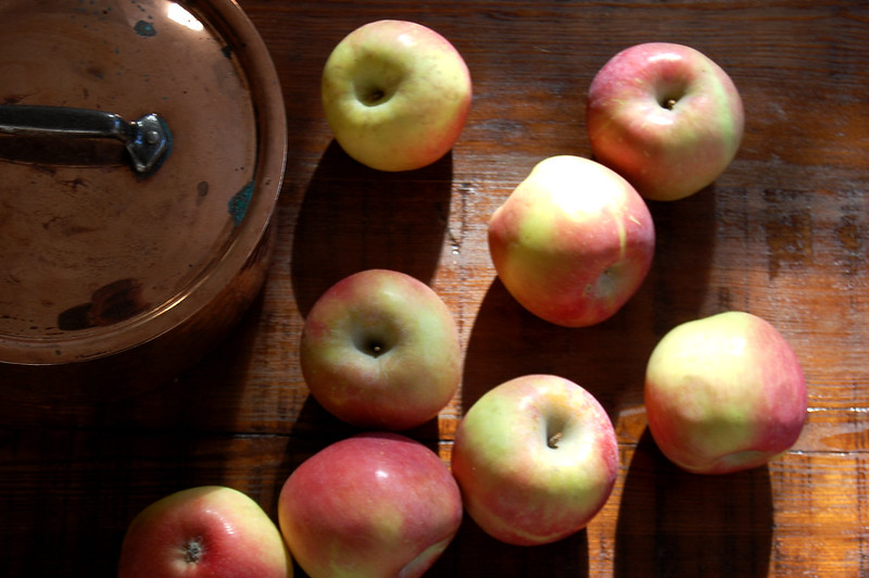 whole apples for applesauce with copper pot