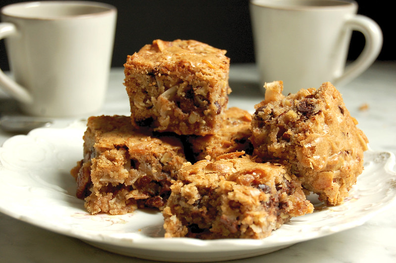 plate of cowboy blondies on dish with coffee