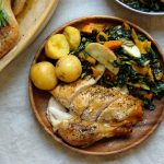 roast chicken platter with salad and potatoes