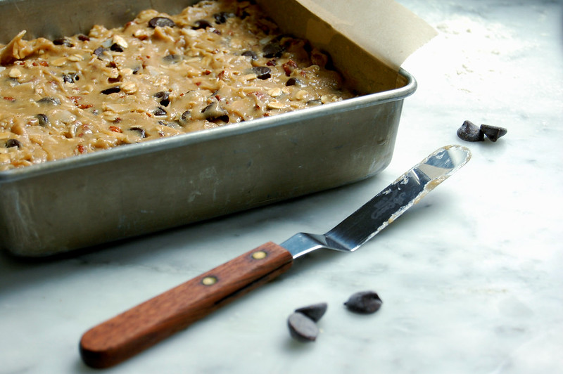 pan of raw cowboy cookie bars dough on marble