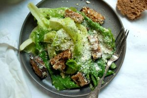 zuni cafe caesar salad on gray plate with fork