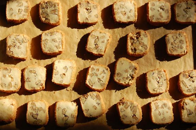 pecan shortbread cookies with sugar rim on baking sheet