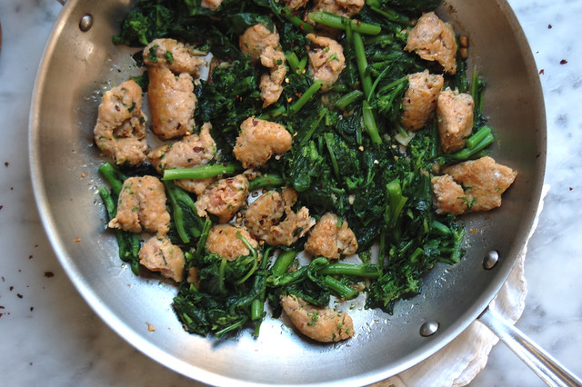 pasta with sausage and greens in pan
