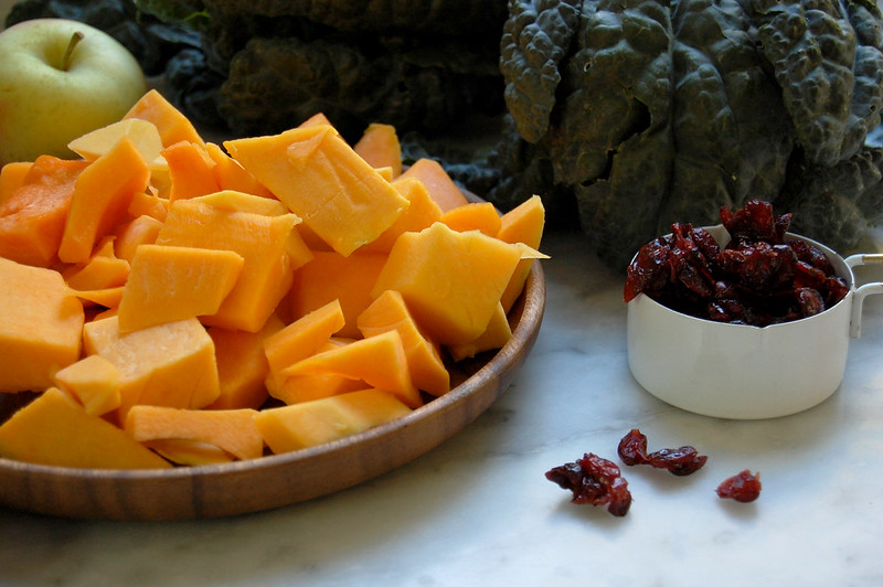 kale salad ingredients of squash cranberries kale