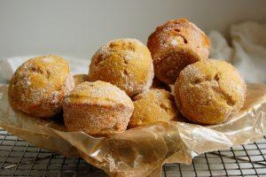 basket of baked pumpkin dounts rolled in cinnamon sugar