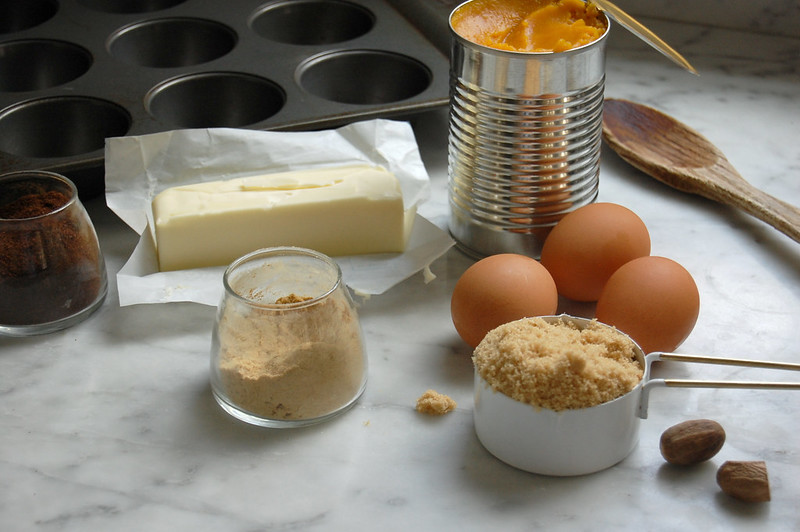 ingredients for donut muffins butter brown sugar eggs pumpkin on marble