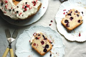 red white blueberry poundcake sliced on plates with fresh berries