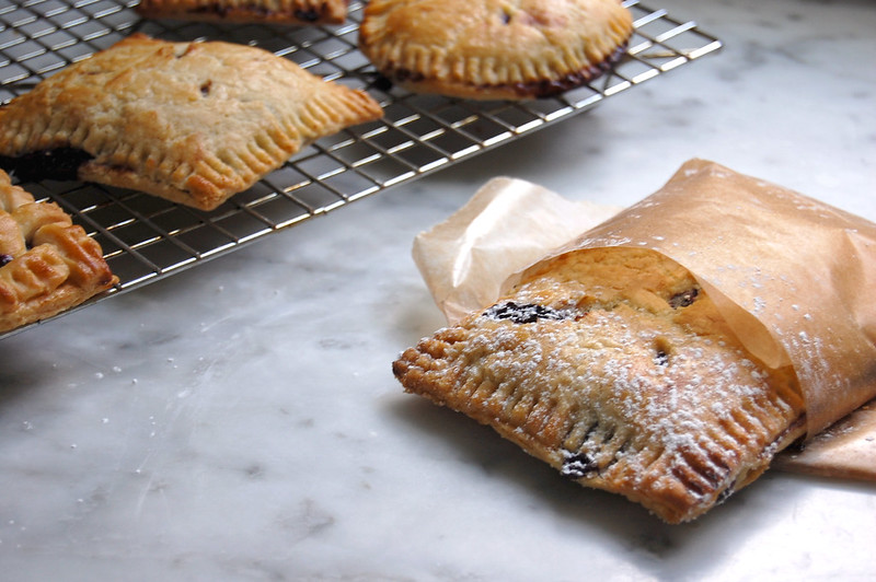 blueberry hand pies wrapped in wax paper