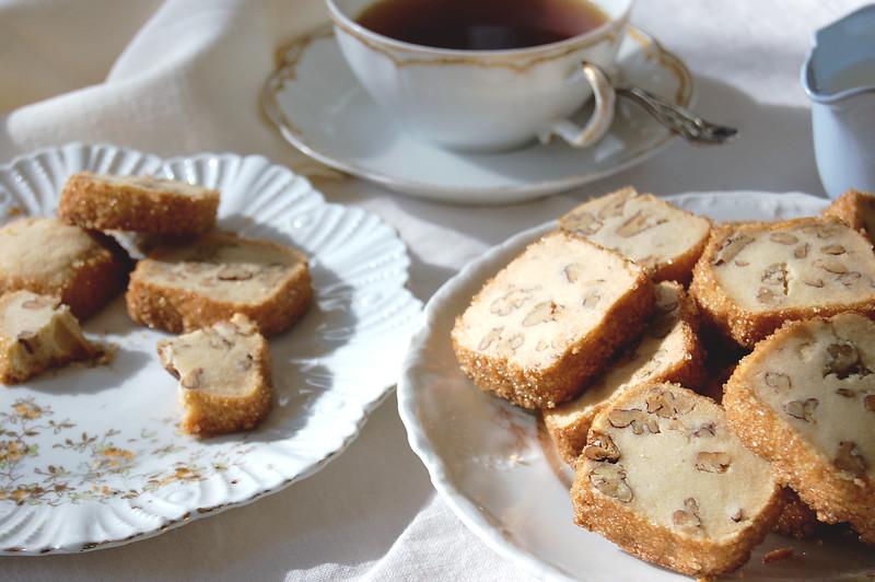 pecan shortbread cookies on platter with tea
