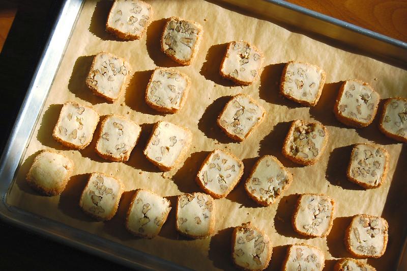 shortbread pecan cookies on baking sheet