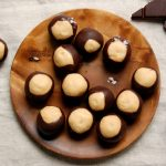 wooden dish with chocolate peanut butter balls buckeyes