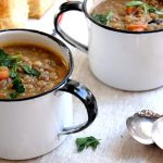 mugs of french lentil soup with biscuit