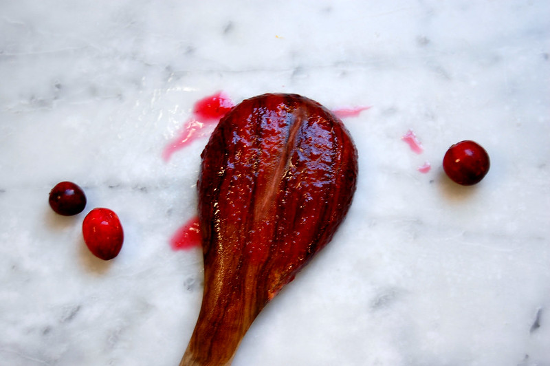 wooden spoon with cranberry sauce