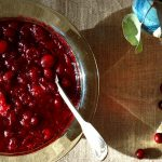 bowl of homemade cranberry sauce with spoon