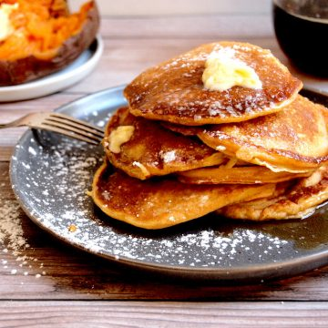 stack of sweet potato pancakes from Thanksgiving leftovers on plate with sugar