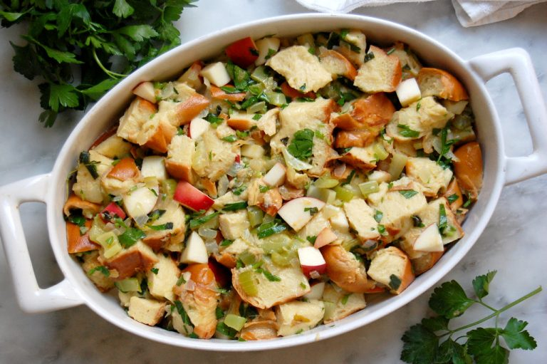casserole of Thanksgiving stuffing dressing with bread apples celery onion parsley