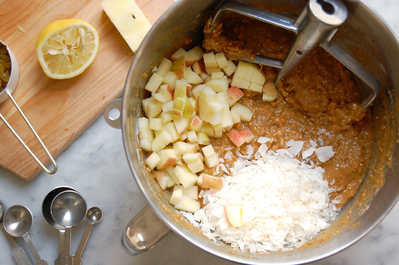 sweet potato morning glory muffin batter in bowl with apple and coconut