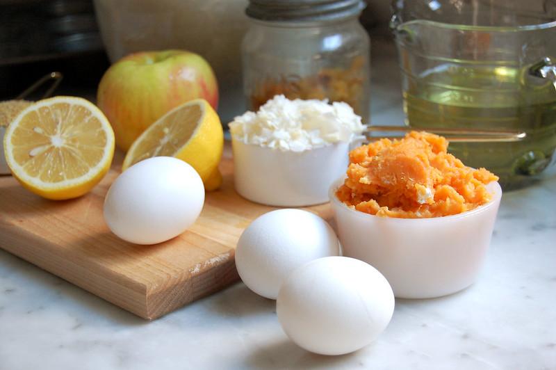 ingredients for sweet potato morning glory muffins eggs, flour, lemon, apple, raisins, oil, nuts, coconut
