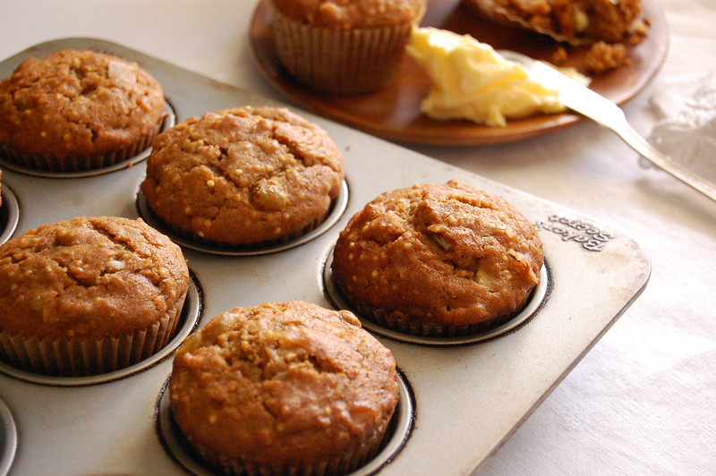 sweet potato morning glory muffins baked in tin with butter and apple