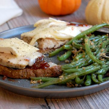 turkey cranberry brie melt on plate with green beans