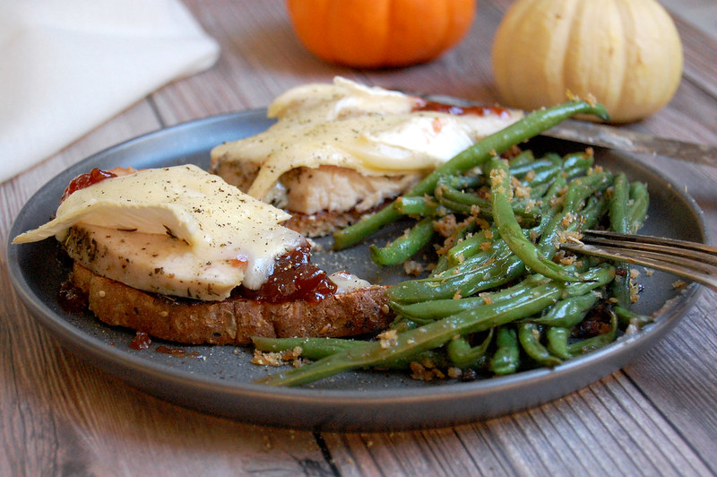 turkey cranberry brie melt on plate with green beans Thanksgiving leftovers recipes