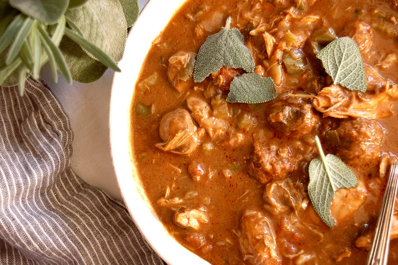 finished turkey gumbo recipe for thanksgiving leftovers in bowl with sage and striped napkin