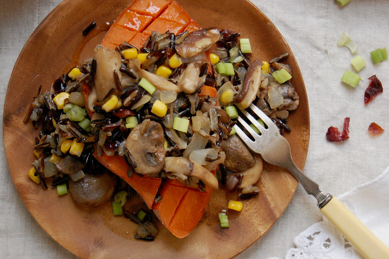 wooden dish with native american wild rice salad with sweet potato corn and mushrooms