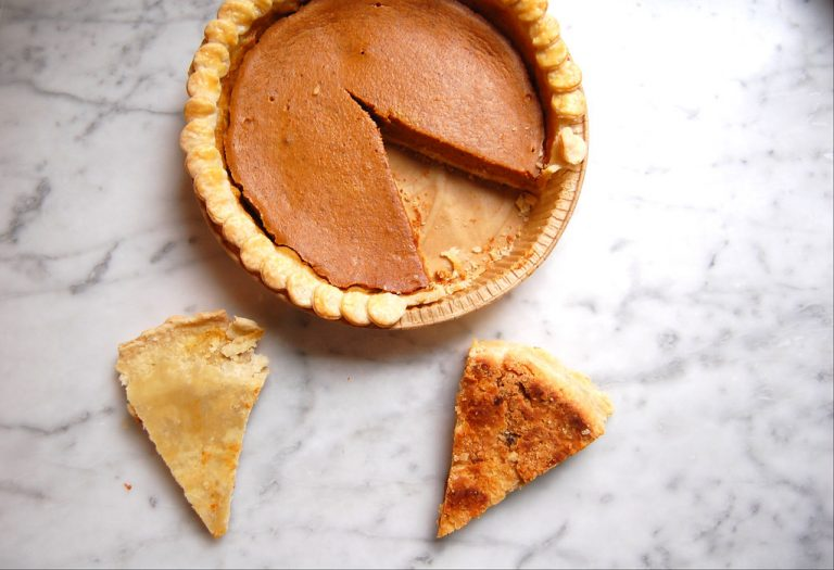 pumpkin pie with two upside-down slices to test best pie pan