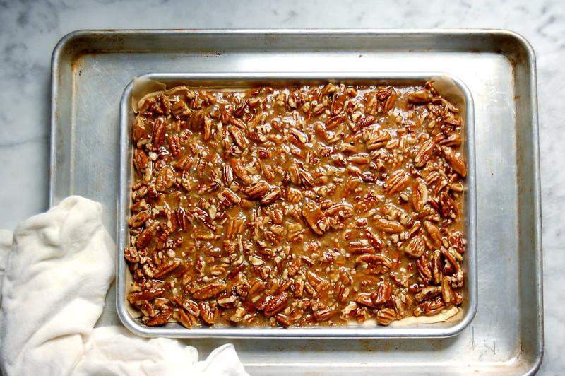 sheet pan with raw pecan pie toffee bar on sheet pan