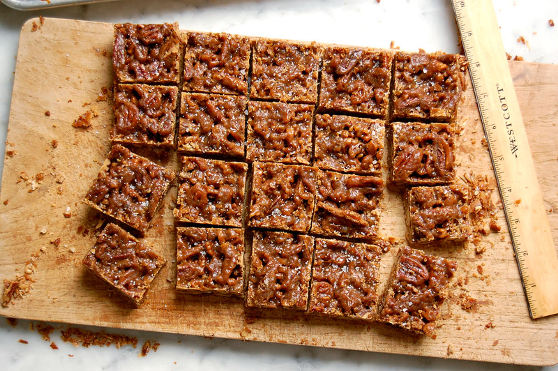 squares of cut pecan pie toffee bars on cutting board