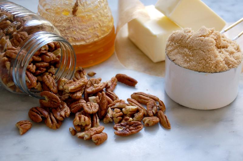 ingredients for pecan bars nuts butter brown sugar honey